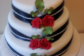 Bold Red Roses on White Fondant with Black Ribbbon