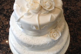 3 tiered Wedding Cake with Sugar roses and handmade leaves