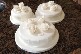 separate 3 tiered wedding cake with Pearls and roses