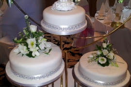 Separate 3 tiered Wedding Cake with Fresh flowers