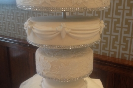 Diamante and swags Upside sown wedding Cake