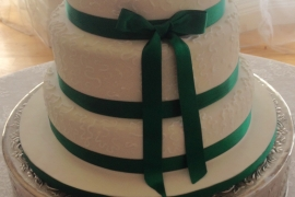 Simple 3 tiered wedding Cake with forest green Ribbon)
