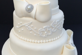 Elegant Bow and Brooch Wedding Cake with Embossing